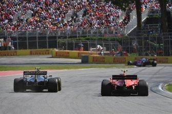 Charles Leclerc, Ferrari SF90, puts a lap on Kevin Magnussen, Haas VF-19