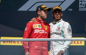 Sebastian Vettel, Ferrari, 2nd position, and Lewis Hamilton, Mercedes AMG F1, 1st position, on the podium