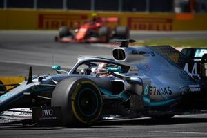 Lewis Hamilton, Mercedes AMG F1 W10, leads Charles Leclerc, Ferrari SF90