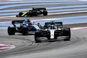 Valtteri Bottas, Mercedes AMG W10, leads Robert Kubica, Williams FW42, and Daniel Ricciardo, Renault F1 Team R.S.19