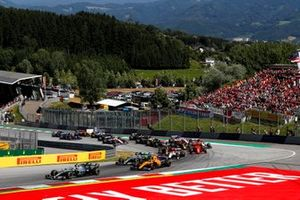 Valtteri Bottas, Mercedes AMG W10, leads Lando Norris, McLaren MCL34, Lewis Hamilton, Mercedes AMG F1 W10, Kimi Raikkonen, Alfa Romeo Racing C38, Max Verstappen, Red Bull Racing RB15, and the remainder of the field at the start