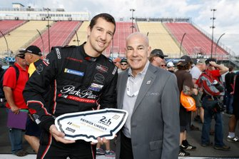 #73 Park Place Motorsports Porsche 911 GT3 R, GTD: Patrick Lindsey receives a special award from IMSA CEO Scott Atherton for his performance at Le Mans.