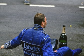 Nigel Mansell, Williams FW14B Renault, 2nd position, sits on the floor of the podium