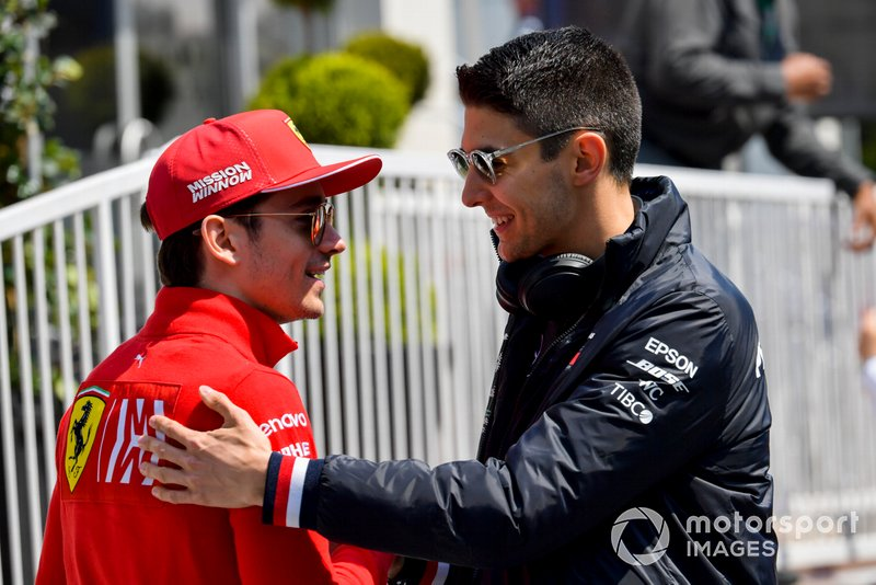 Charles Leclerc, Ferrari ed Esteban Ocon, Mercedes AMG F1, nel paddock