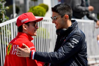 Charles Leclerc, Ferrari and Esteban Ocon, Mercedes AMG F1 in the paddock