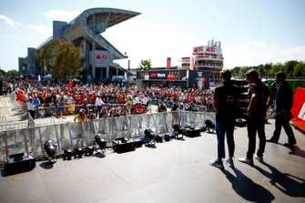 Kevin Magnussen, Haas F1 and Romain Grosjean, Haas F1 on stage at the Fan Zone