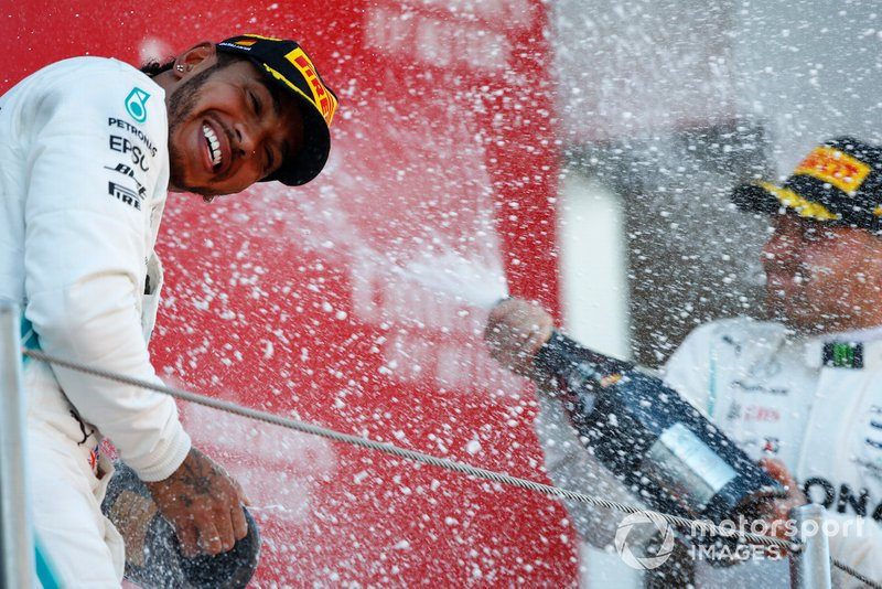 Lewis Hamilton, Mercedes AMG F1, 1st position, is blasted with Champagne by Valtteri Bottas, Mercedes AMG F1, 2nd position, on the podium