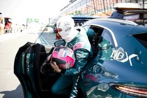 Sebastian Vettel, Aston Martin, is returned to the pit lane by the Medical car
