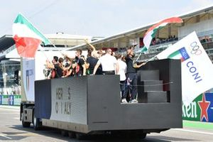 The Euro 2020 trophy and Italian Football and Olympic stars form a parade of champions