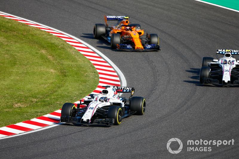 Lance Stroll, Williams FW41, Sergey Sirotkin, Williams FW41, y Stoffel Vandoorne, McLaren MCL33