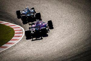 Romain Grosjean, Haas F1 Team VF-18, leads Sergio Perez, Racing Point Force India VJM11