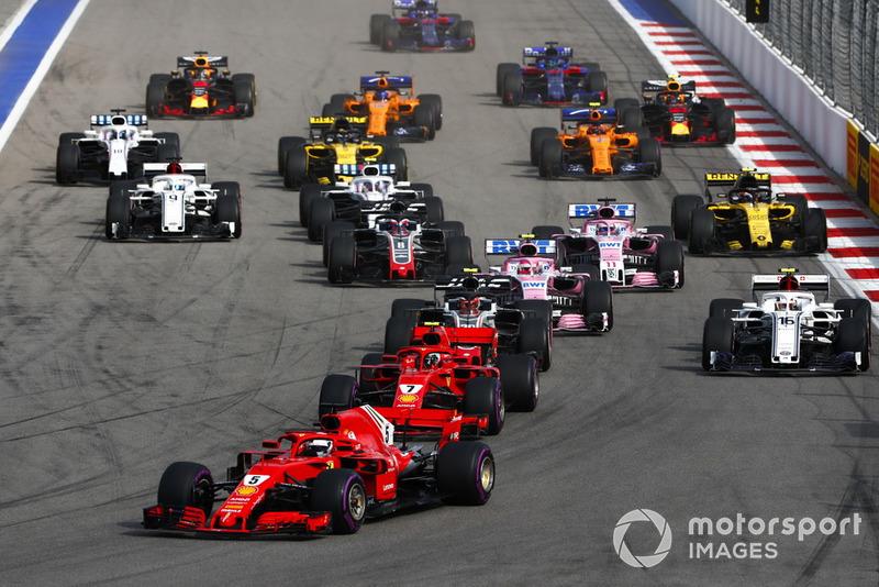 Arrancada, Sebastian Vettel, Ferrari SF71H, Kimi Raikkonen, Ferrari SF71H y Kevin Magnussen, Haas F1 Team VF-18
