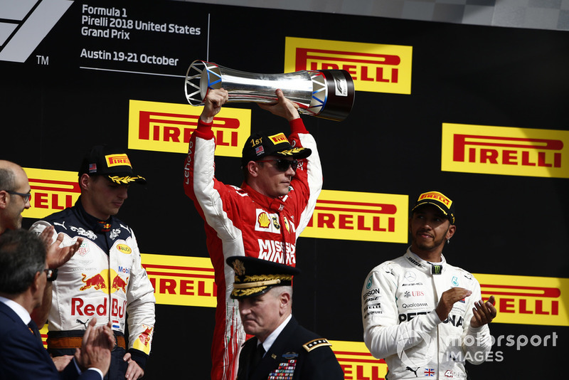 Max Verstappen, Red Bull Racing, 2nd position, Kimi Raikkonen, Ferrari, 1st position, with his trophy, and Lewis Hamilton, Mercedes AMG F1, 3rd position, on the podium