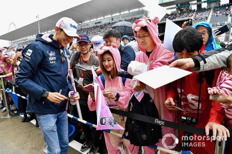 Esteban Ocon, Racing Point Force India F1 Team signs autographs for fans