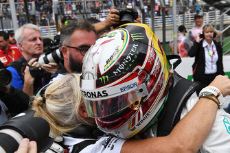 Lewis Hamilton, Mercedes AMG F1 and Angela Cullen, PA, physio and trainer celebrate in parc ferme