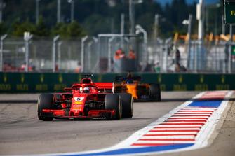 Sebastian Vettel, Ferrari SF71H, leads Fernando Alonso, McLaren MCL33