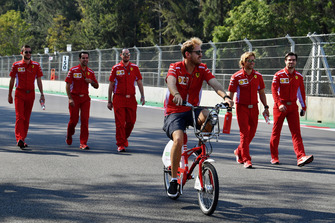 Sebastian Vettel, Ferrari rides a bike on the track walk