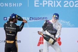 Jean-Eric Vergne, DS Techeetah, second position, Maximilian Guenther, BMW I Andretti Motorsport, first position, celebrate on the podium with Champagne
