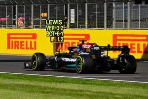 Lewis Hamilton, Mercedes W12, passes his pit board