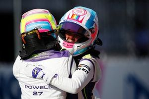 Alice Powell celebrates with Sarah Moore after winning the race