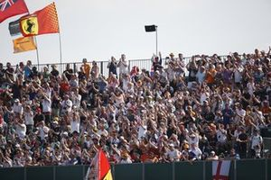 Fans cheer from the grandstands as Lewis Hamilton, Mercedes, takes the lead