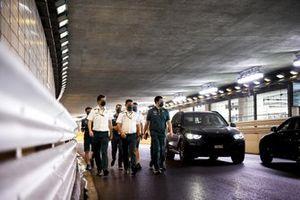 Sebastian Vettel, Aston Martin, walks through the tunnel with team mates