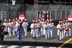 A brass marching band on the grid
