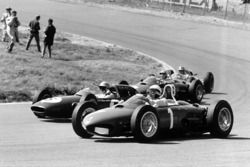 Phil Hill, Ferrari Dino 156, takes a wide line through Tarzan Corner while Trevor Taylor, Lotus 24-C