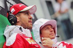 Sebastian Vettel, Ferrari with team mate Kimi Raikkonen, Ferrari on the drivers parade
