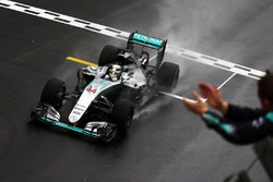 Race winner Lewis Hamilton, Mercedes AMG F1 W07 Hybrid celebrates as he takes the chequered flag at