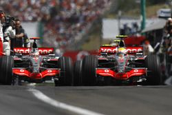 Lewis Hamilton, McLaren MP4-22, leads team mate Fernando Alonso, McLaren MP4-22 out of the pits