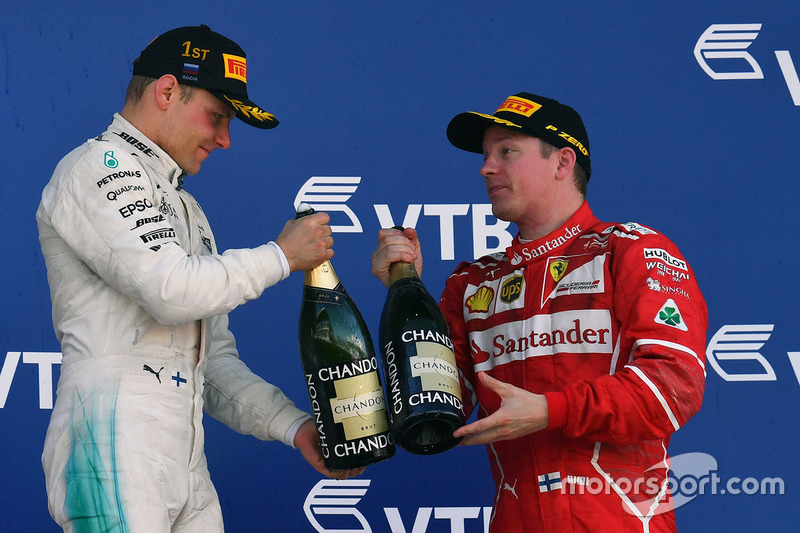 Kimi Raikkonen, Ferrari and Race winner Valtteri Bottas, Mercedes AMG F1