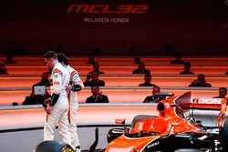 Race drivers Stoffel Vandoorne and Fernando Alonso leave the stage at the launch of the McLaren MCL3