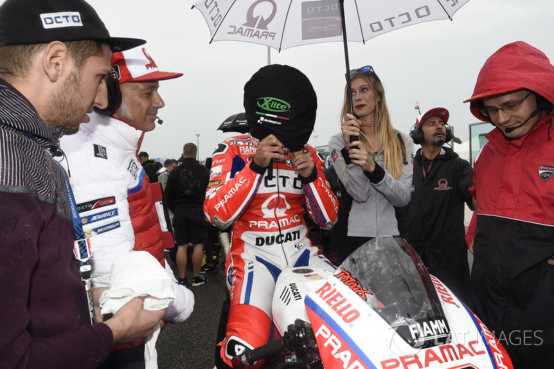 Danilo Petrucci, Pramac Racing, putting his helmet on with the cover still on