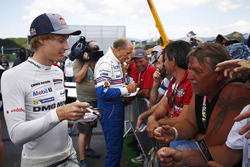 Brendon Hartley and Hans-Joachim Stuck sign autographs