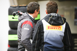 Guenther Steiner, Team Principal, Haas F1 Team, with Mario Isola, Racing Manager, Pirelli Motorsport