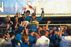 Race winner and World Champion Michael Schumacher, Benetton celebrates with Flavio Briatore and the
