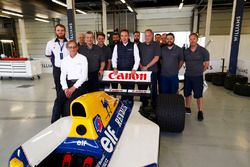 A group photo next to the Williams FW14B Renault with Dickie Stanford, Jonathan Williams