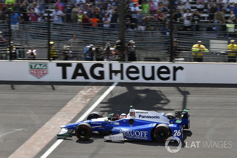 Takuma Sato, Andretti Autosport Honda crosses the finish line and the yard of bricks under the checkered flag for the win