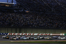 Martin Truex Jr., Furniture Row Racing Toyota, Kyle Busch, Joe Gibbs Racing Toyota lead the field on a restart