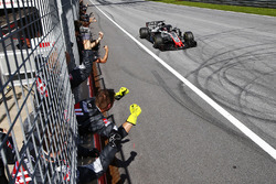 Romain Grosjean, Haas F1 Team VF-18, is congratulated by his team at the finish