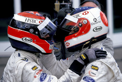 Rubens Barrichello, celebrates with Johnny Herbert, in Parc Ferme