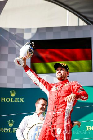 Sebastian Vettel, Ferrari, 2nd position, with his trophy on the podium