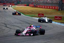 Esteban Ocon, Force India VJM11, leads Marcus Ericsson, Sauber C37, and Daniel Ricciardo, Red Bull Racing RB14