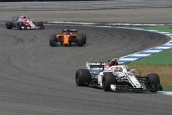 Charles Leclerc, Sauber C37, Fernando Alonso, McLaren MCL33 and Esteban Ocon, Force India VJM11