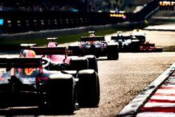 Max Verstappen, Red Bull Racing RB14 Tag Heuer, Kimi Raikkonen, Ferrari SF71H, and Daniel Ricciardo, Red Bull Racing RB14 Tag Heuer