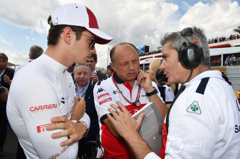 Charles Leclerc, Sauber, Frederic Vasseur, Sauber, Team Principal and Xevi Pujolar, Sauber Head of Track Engineering on the grid