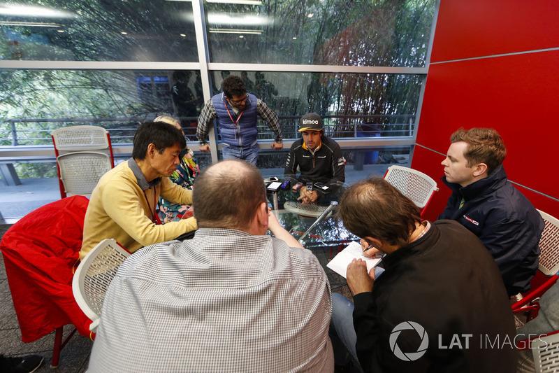 Fernando Alonso, McLaren, speaks to reporters