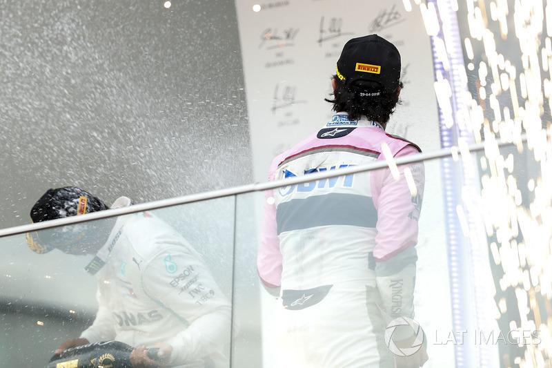 Podium: race winner Lewis Hamilton, Mercedes-AMG F1, Ferrari, third place Sergio Perez, Force India celebrate with the champagne