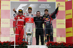 The podium: Fernando Alonso, Ferrari, second; Jenson Button, McLaren, race winner; Paddy Lowe, McLaren Technical Director; Sebastian Vettel, Red Bull Racing, third and World Champion